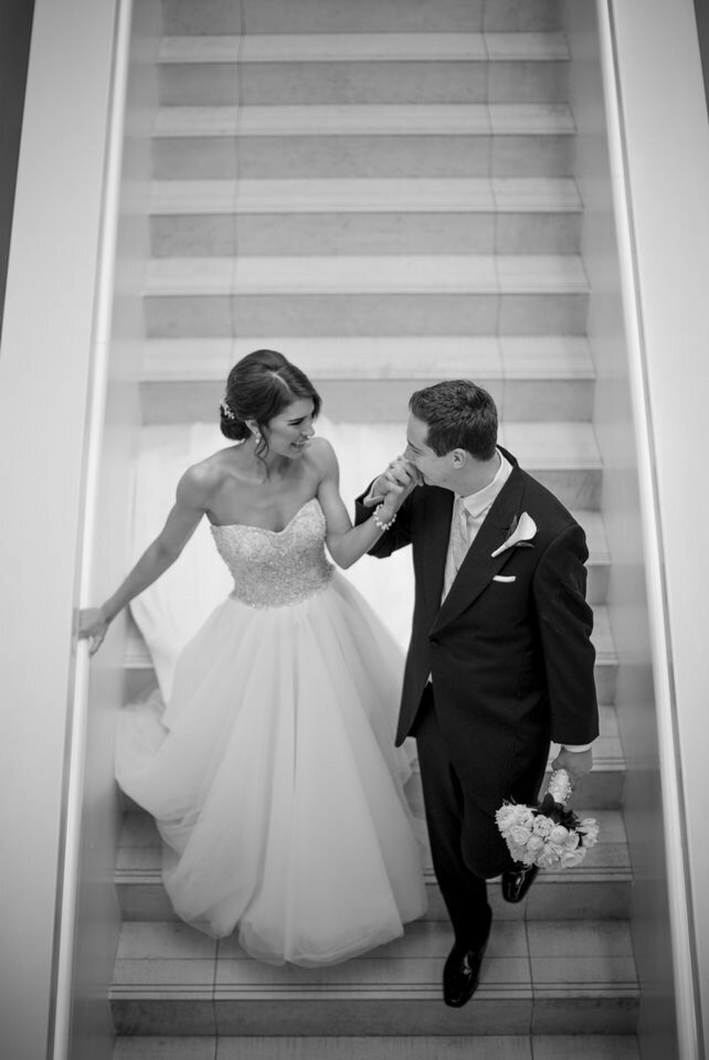 bride and groom on the iconic staircase of the w hotel