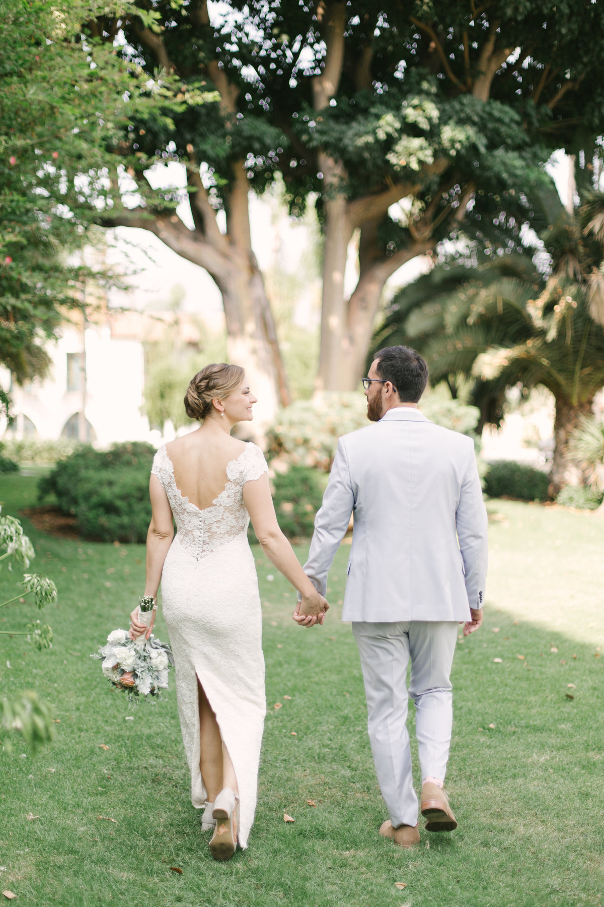 Bride and groom walk at Santa Barbara Courthouse wedding