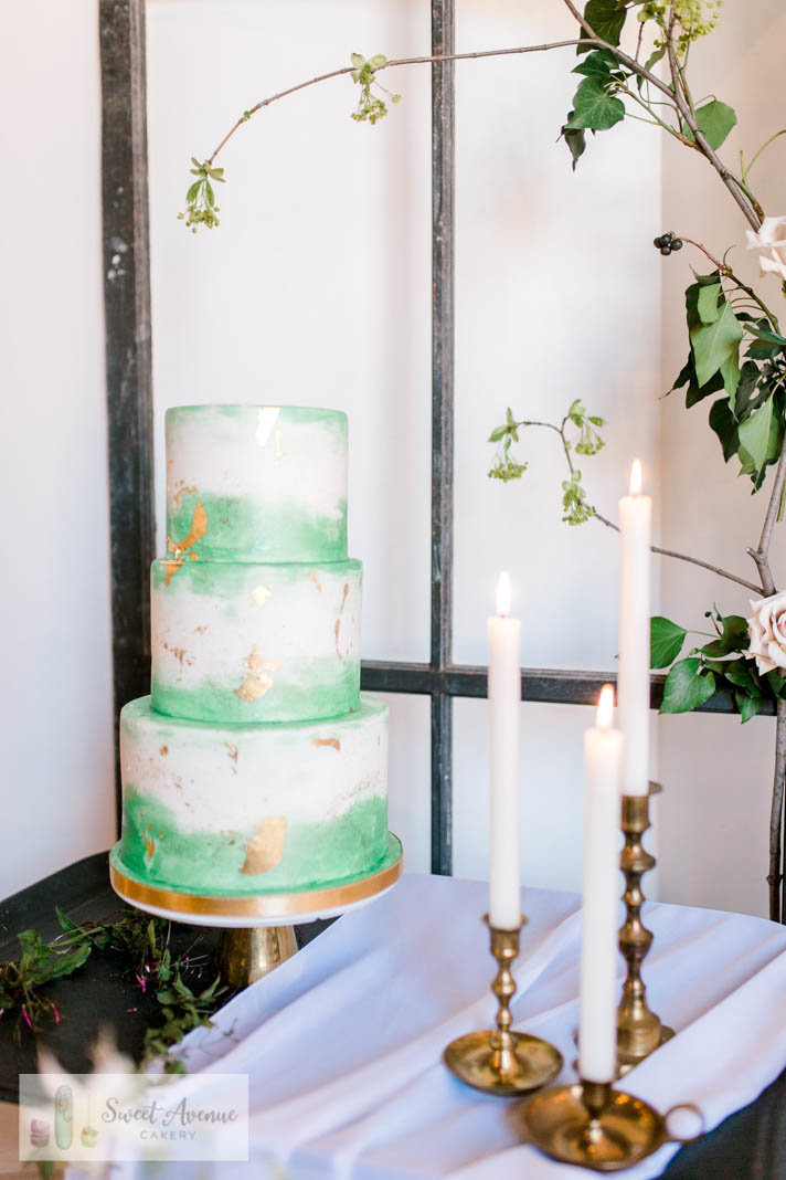 modern green and white watercolor wedding cake with gold foil