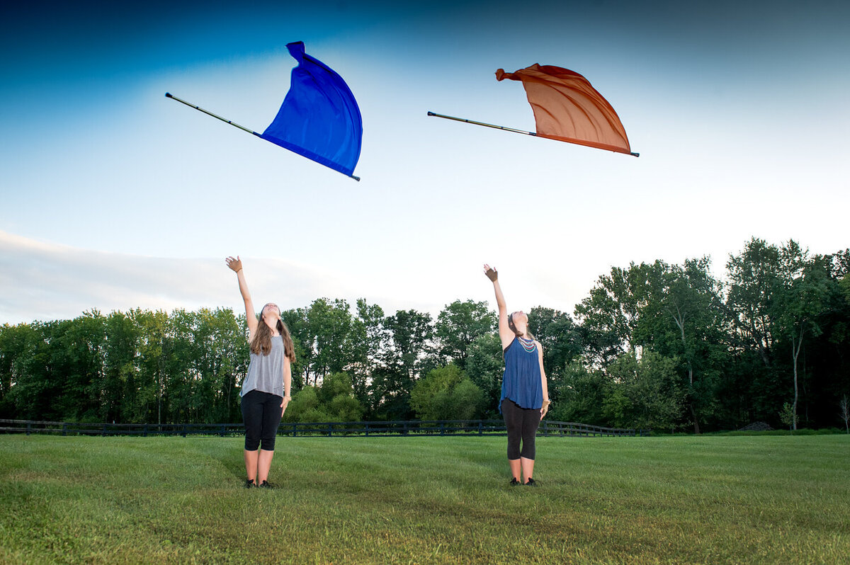 twin senior girls color guard open field toss flags