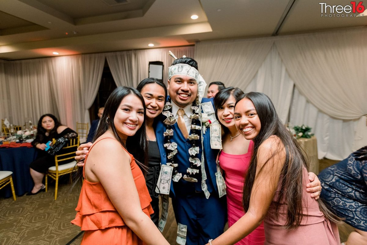 Girls surround the Groom during the Money Dance
