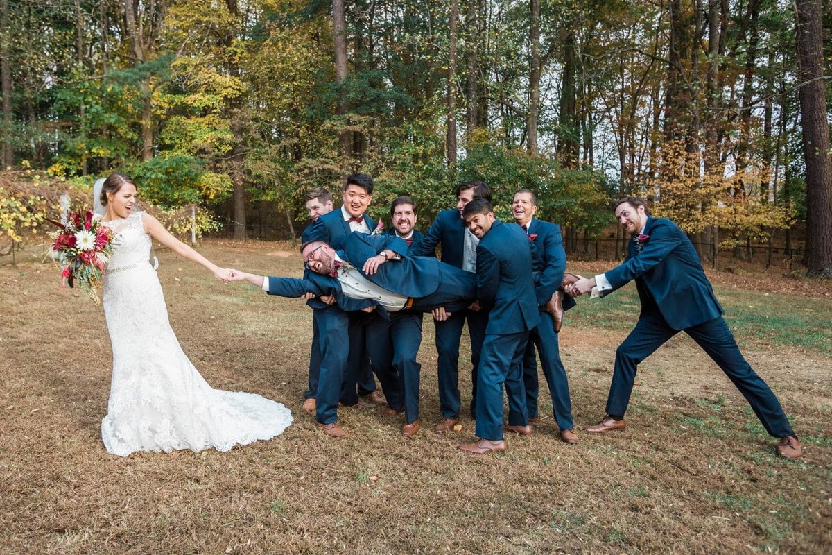bride pulls groom from groomsmen
