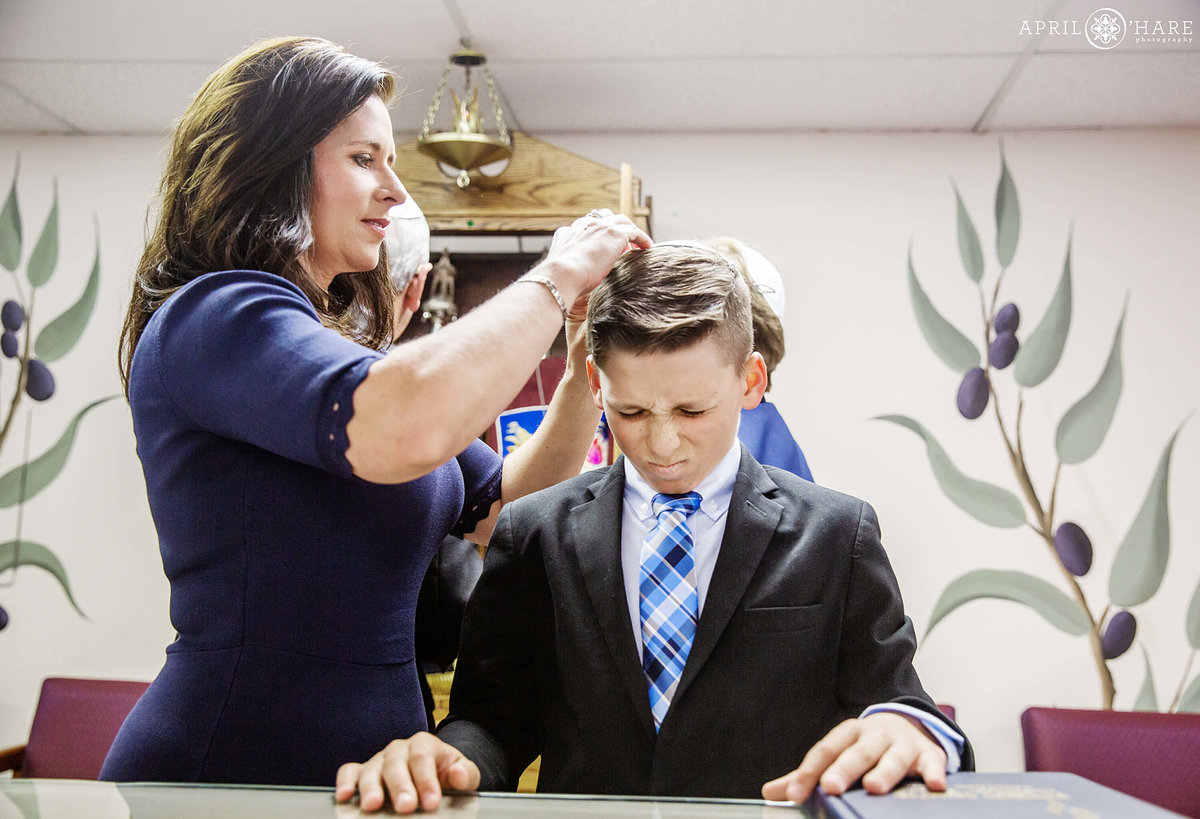 Mom helps son with his Yarmulke at B'Nai Chaim Synagogue in Denver CO