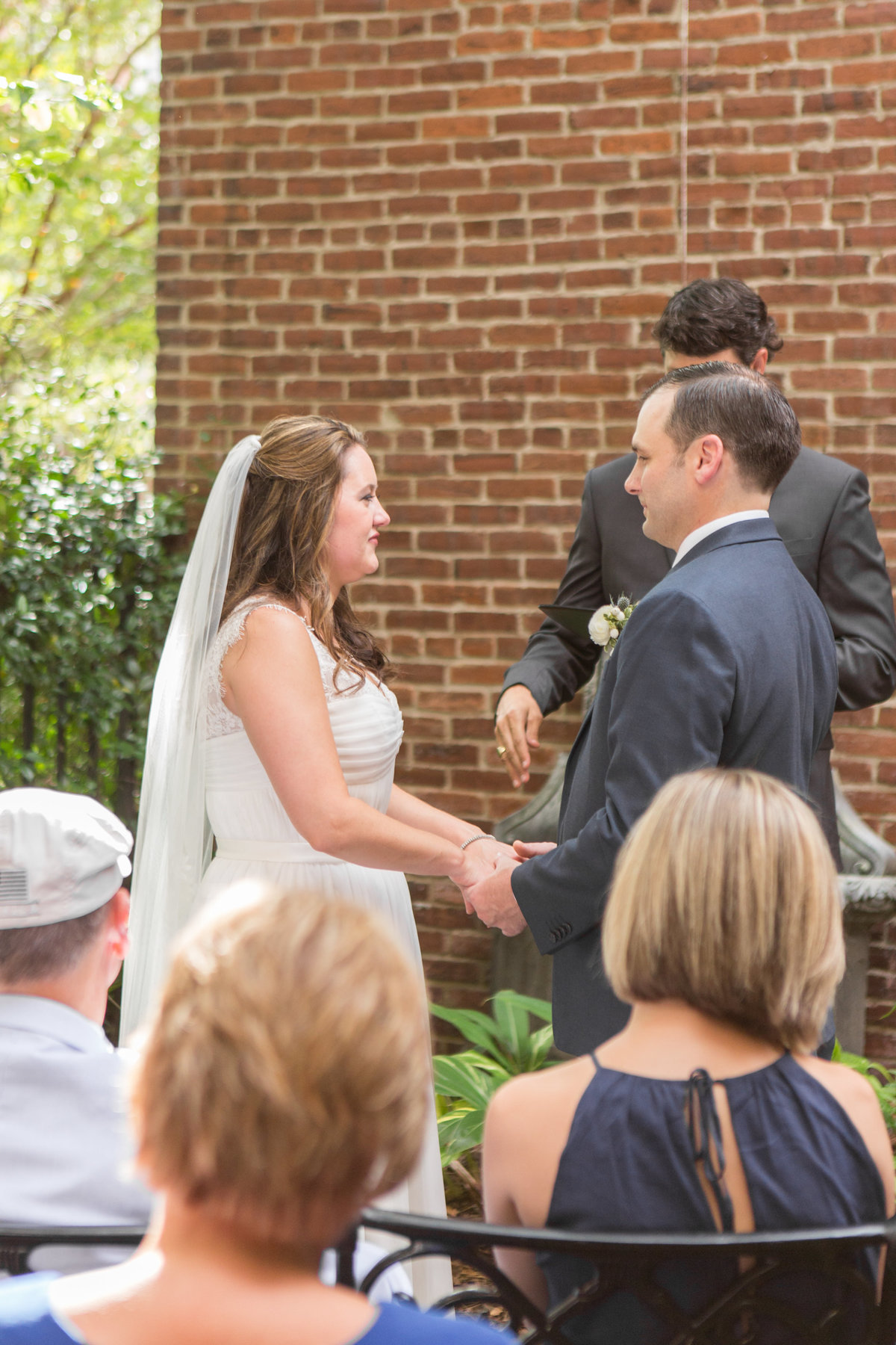 bride and groom saying vows at kehoe house destination wedding