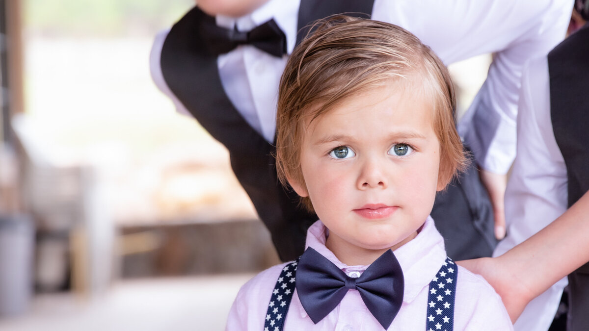 cut boy in bow tie