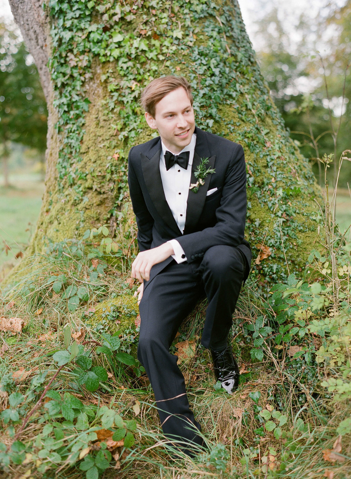 40-KTMerry-weddings-groom-against-tree-Ireland