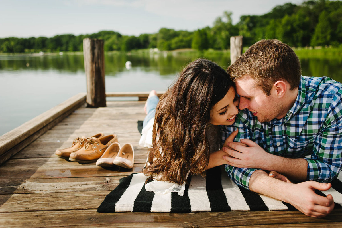 couple kissing at white rock lake during their dallas engagement session