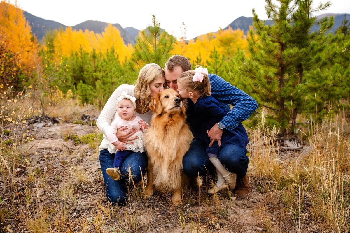 Parents with their children and beautiful dog