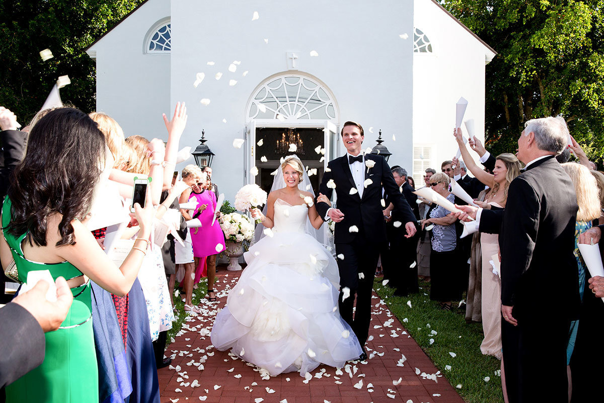trinity by the cove naples florida bride and groom leaving church