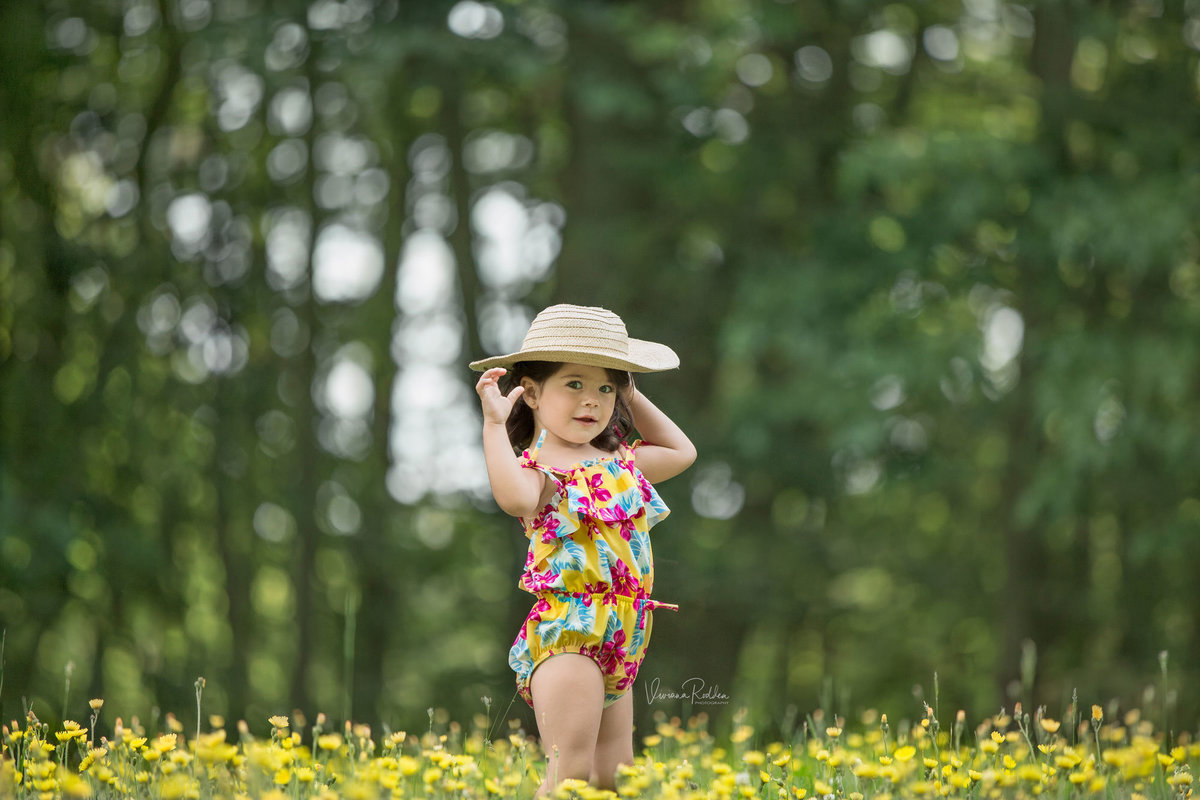 Child with swimsuit in the field session