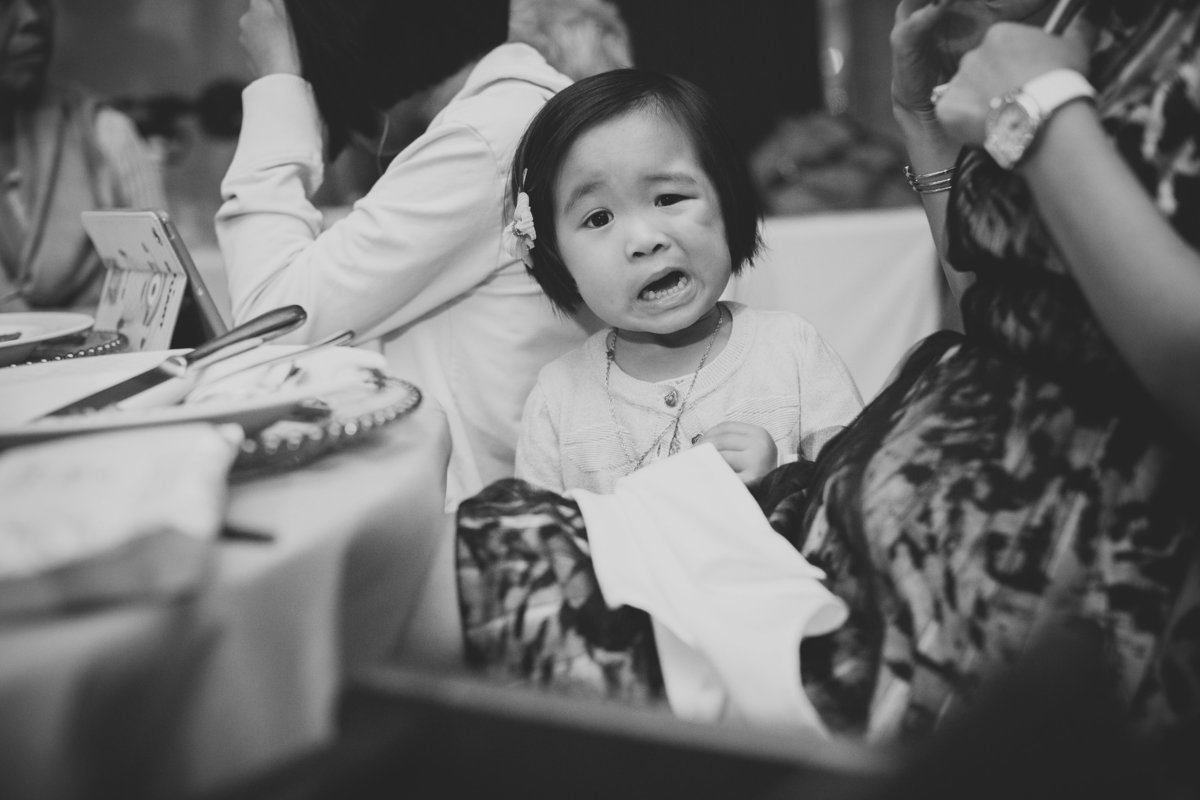 girl pulling a funny expression in the wedding breakfast