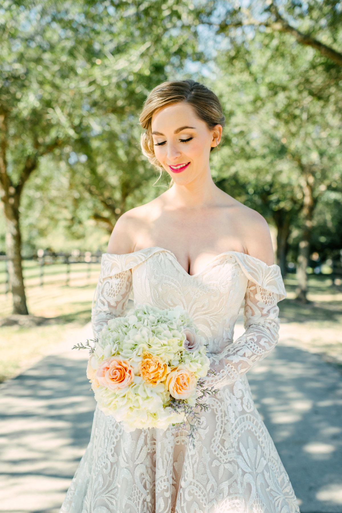 bride poses with bouquet