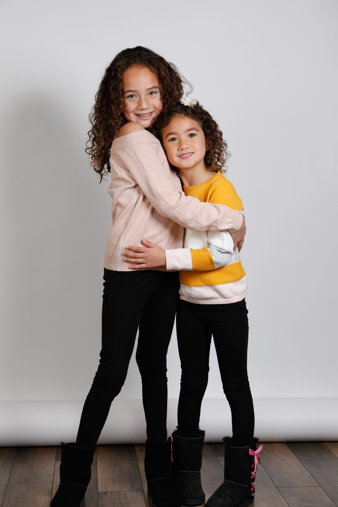 Family photoshoot in palo alto studio, loving girls