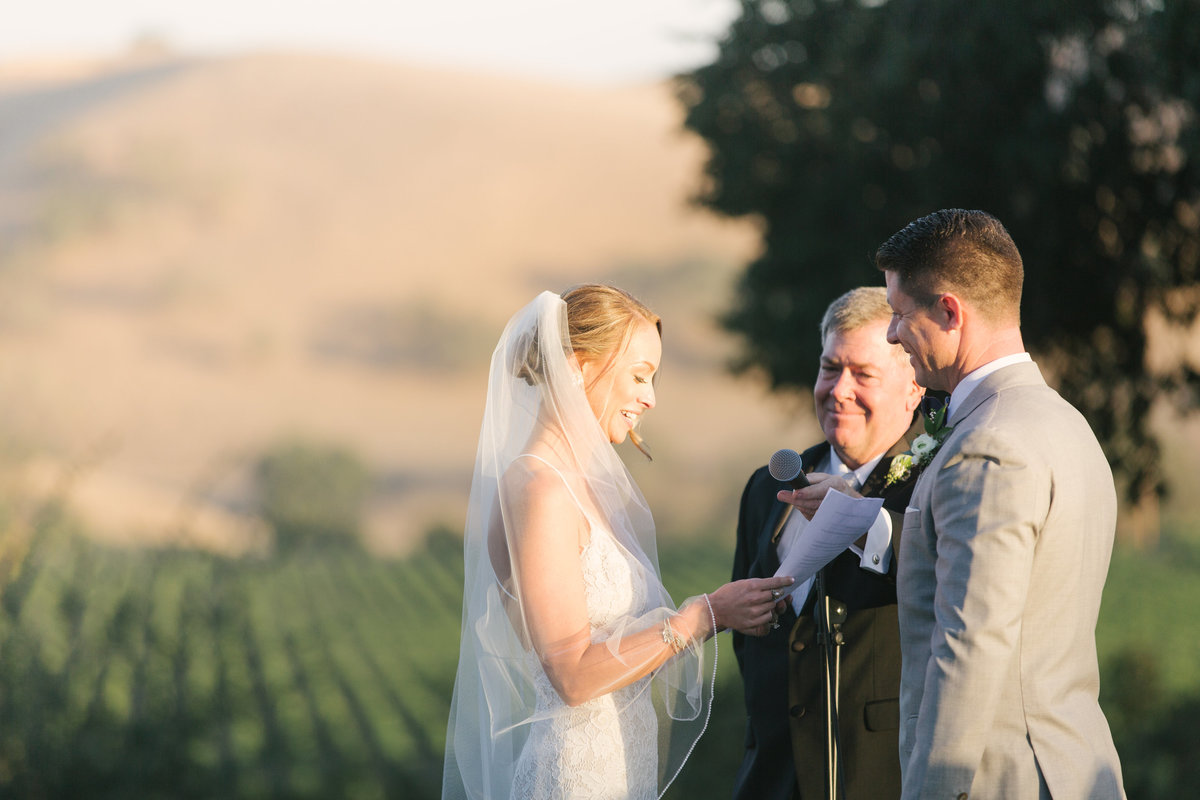 Bride recites vows at Firestone wedding