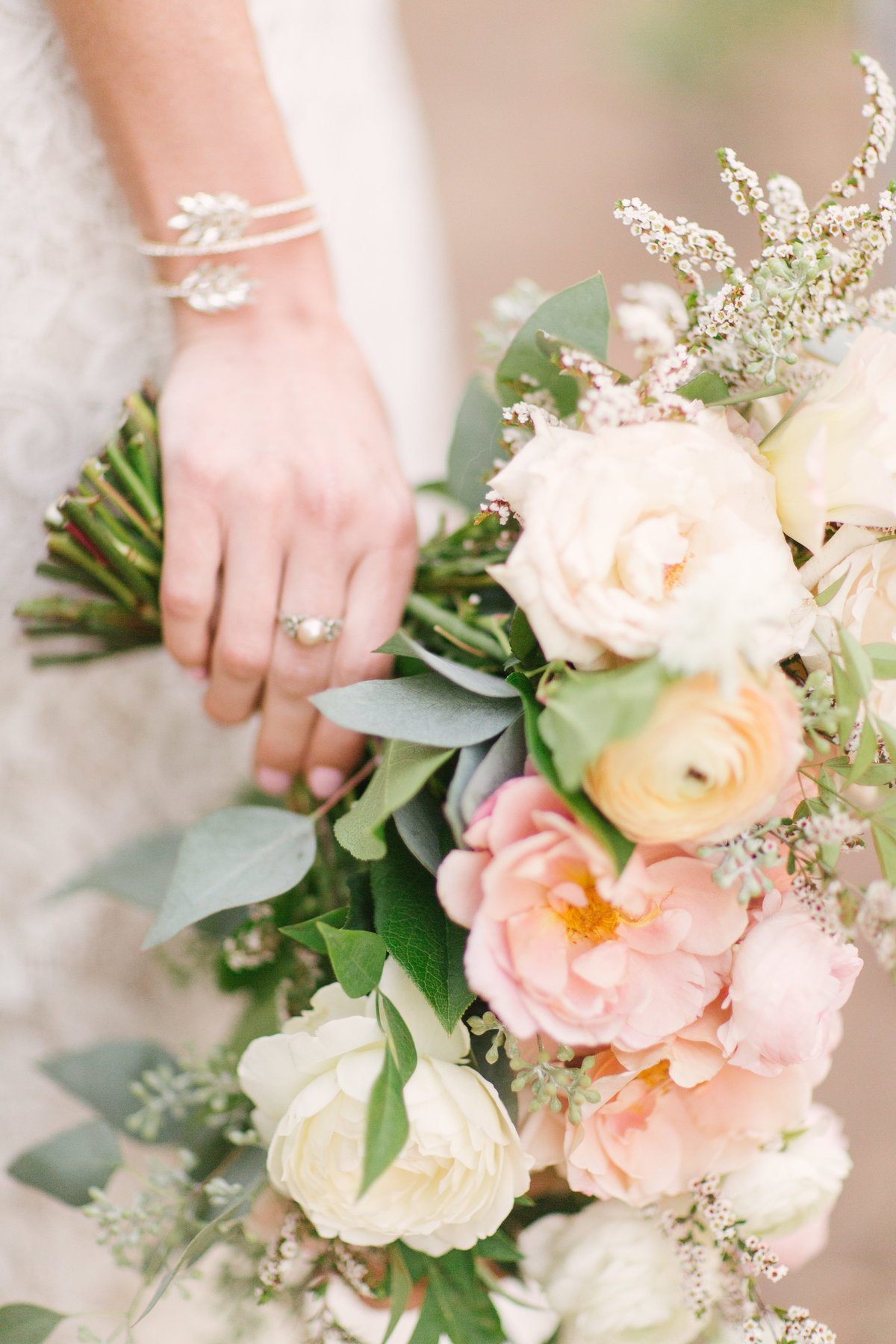 Brides jewelry and bouquet at Firestone Vineyard wedding