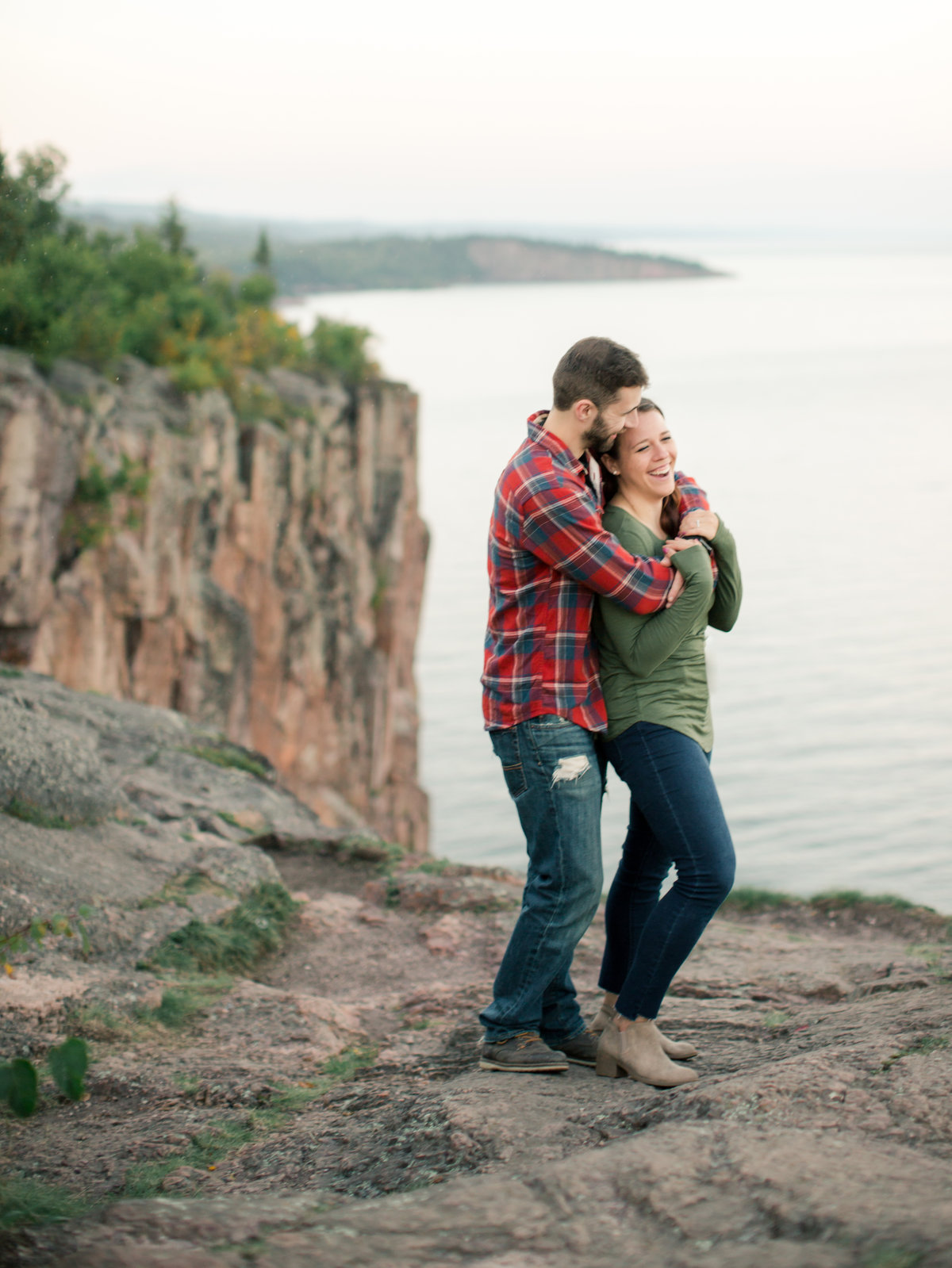 couple stands on top of palisade head minnesota