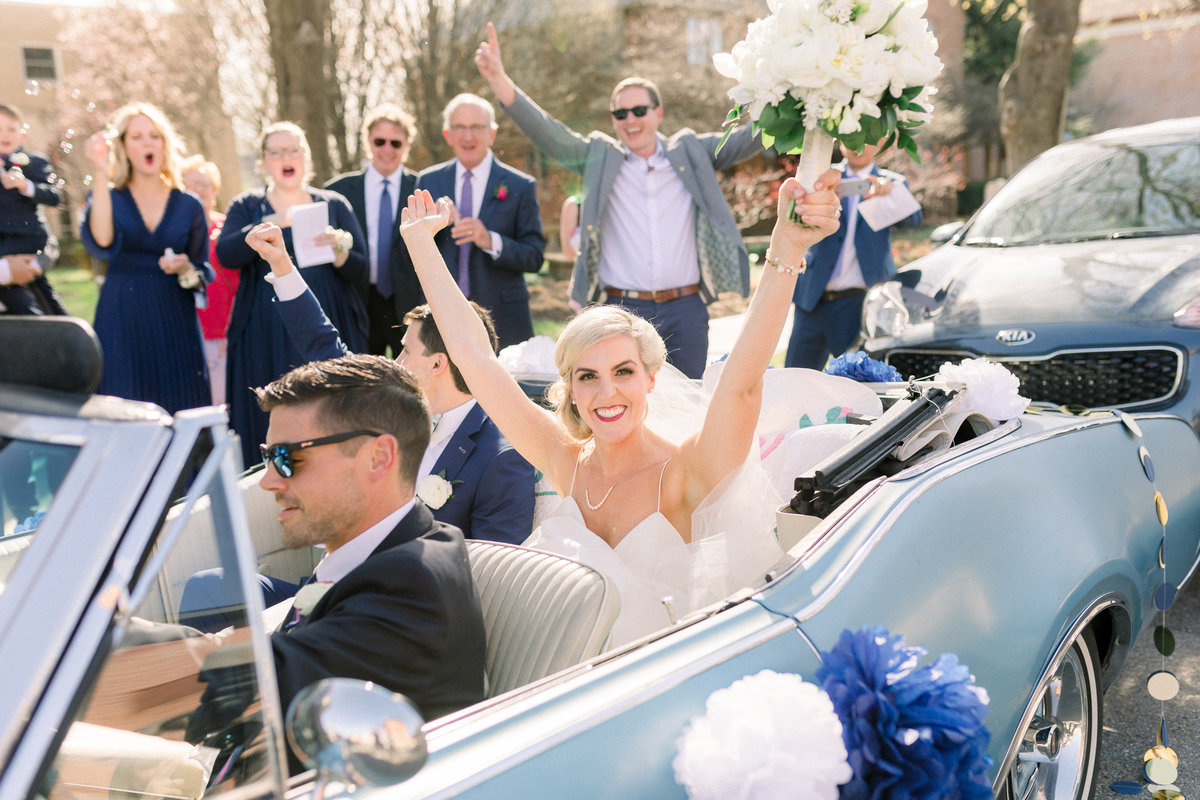 Bride and groom in their getaway on their wedding day in Ohio
