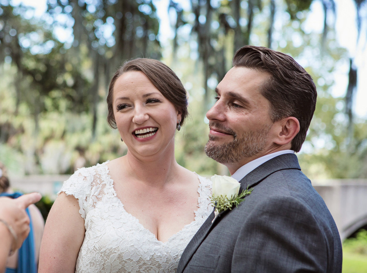 bride smiles at groom during elopement ceremony in City Park, New Orleans, Louisiana