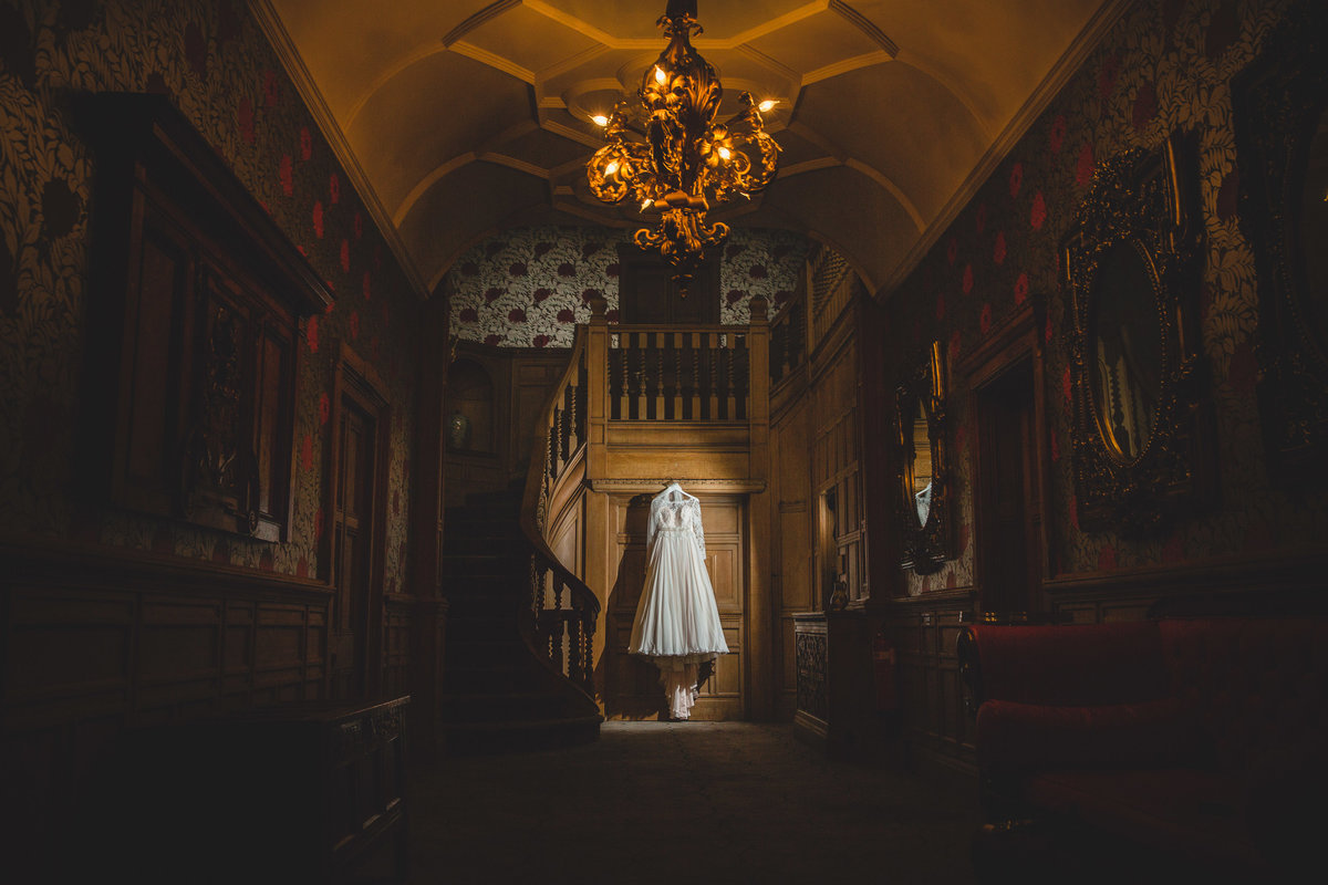 a wedding dress hanging at thornbridge hall