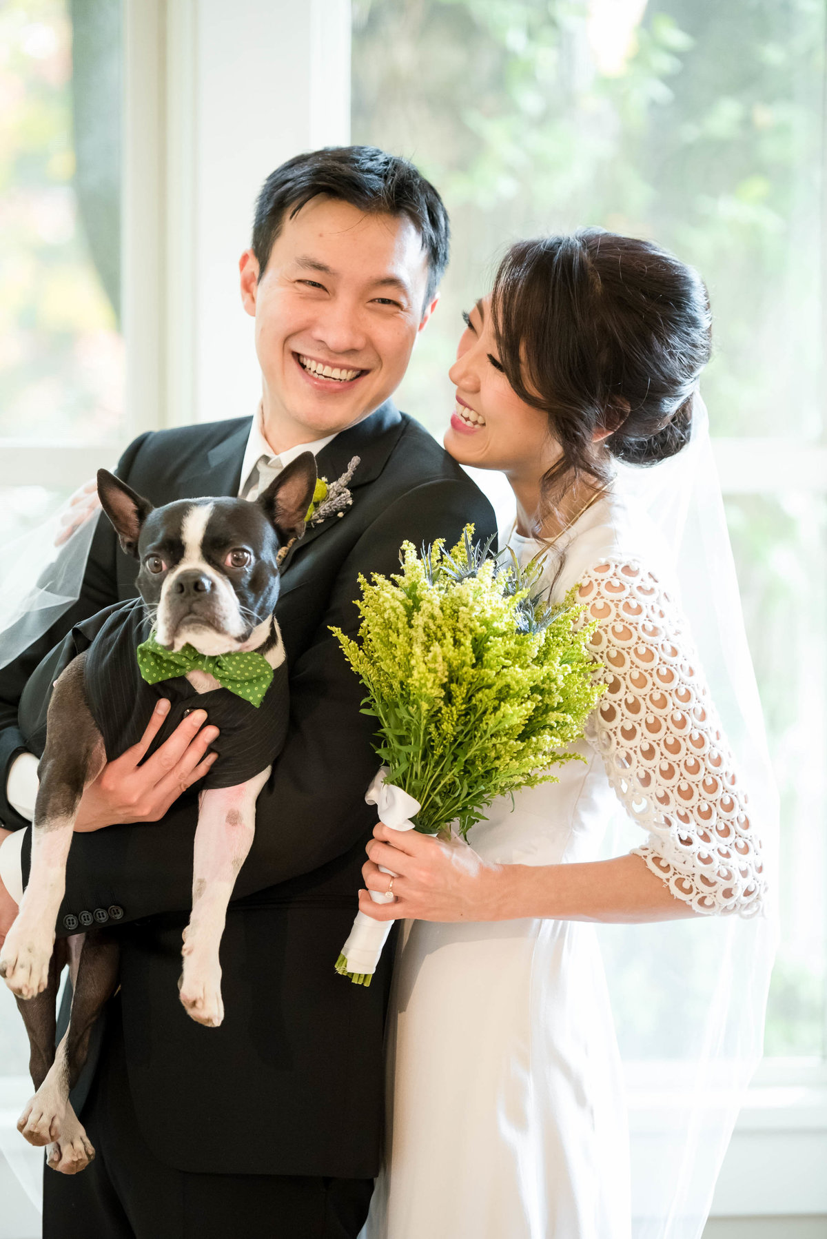 bride and groom with their pup