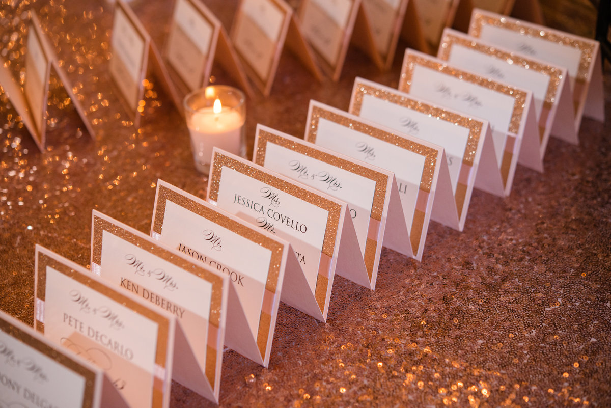 Gold and white place cards for a wedding at Glen Cove Mansion