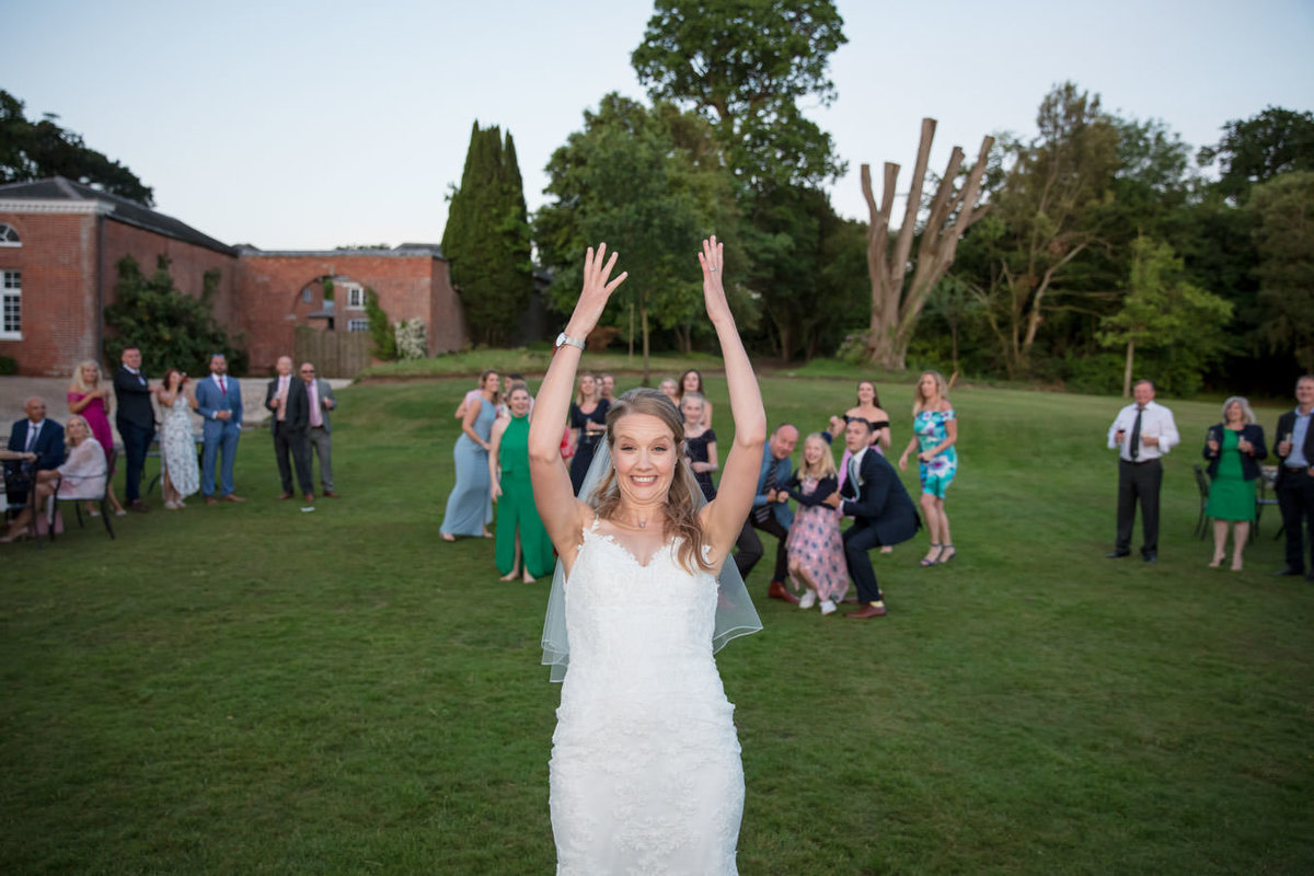 Throwing bouquet at Rockbeare Manor Wedding