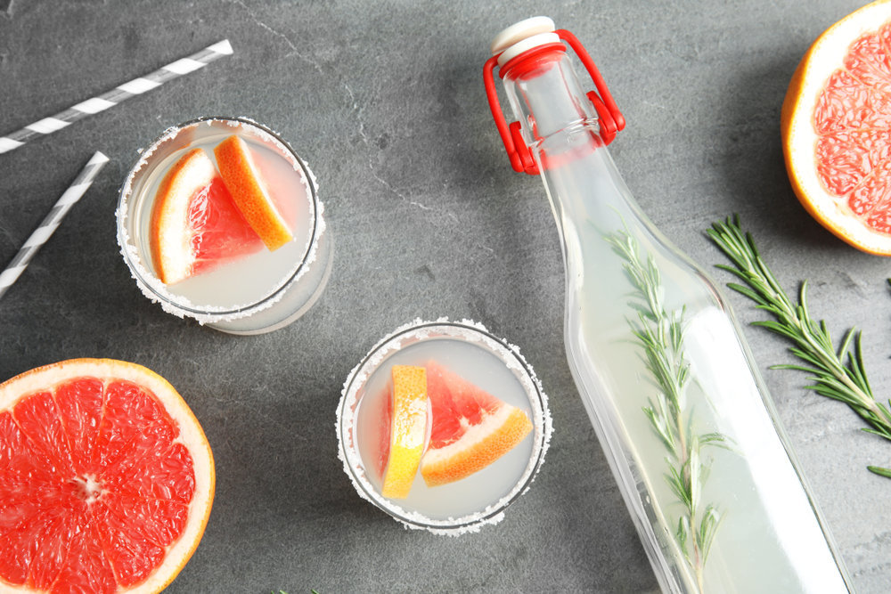 Specialty cocktails made with grapefruit & herb infused simple syrup