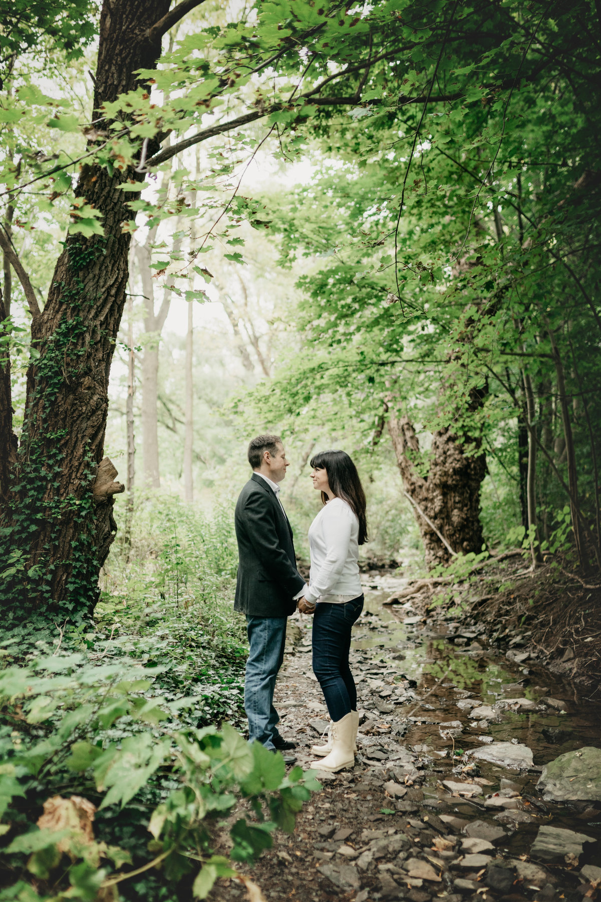 Couple looking at each other in the woods