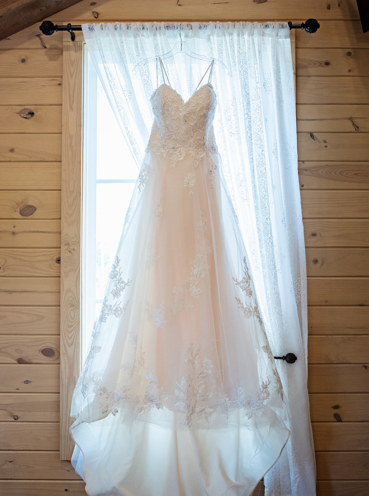 wedding-dress-hanging-in-window