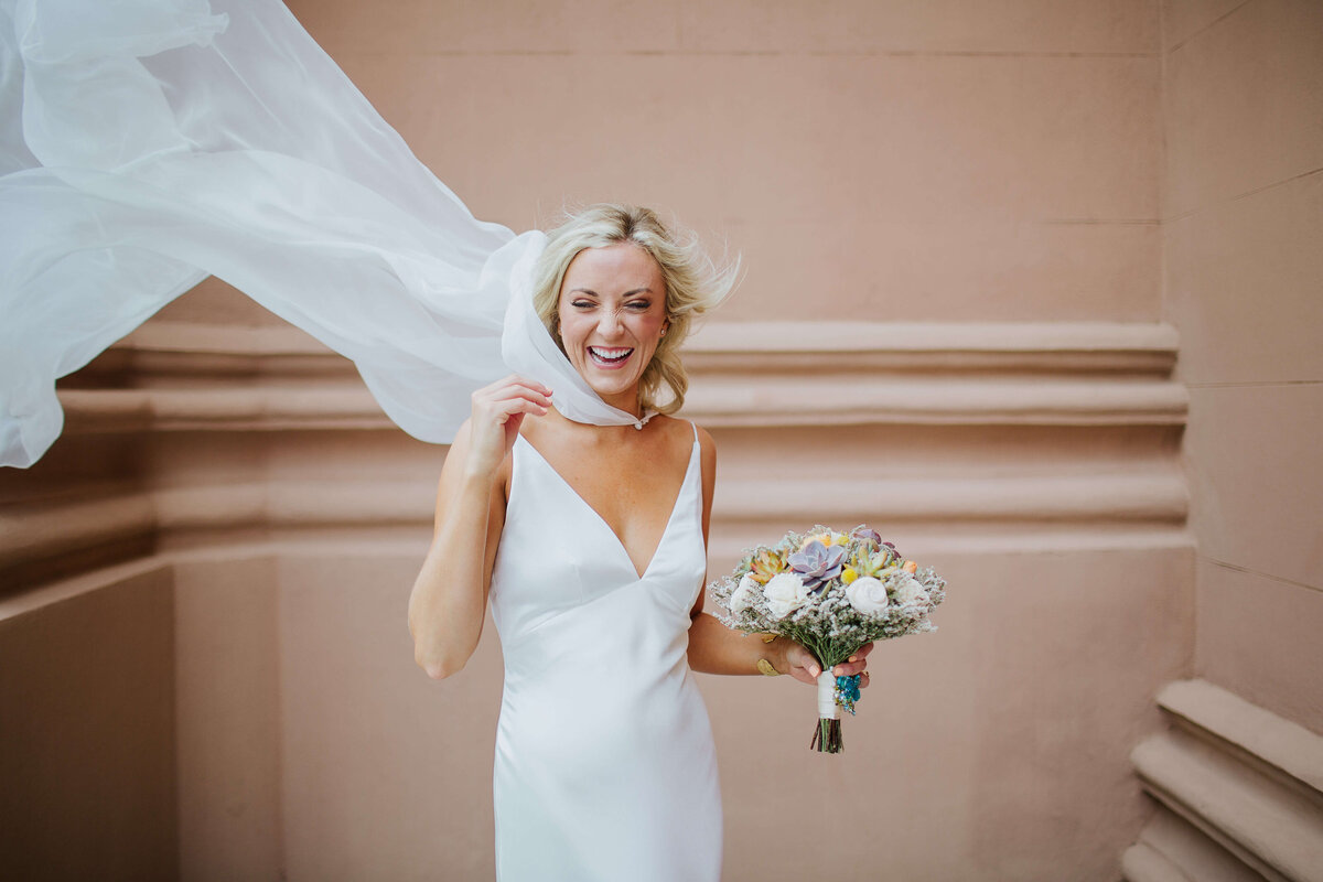 Bridal cape by Tatyana Merenyuk, Satin sheath gown by Theia Bridal