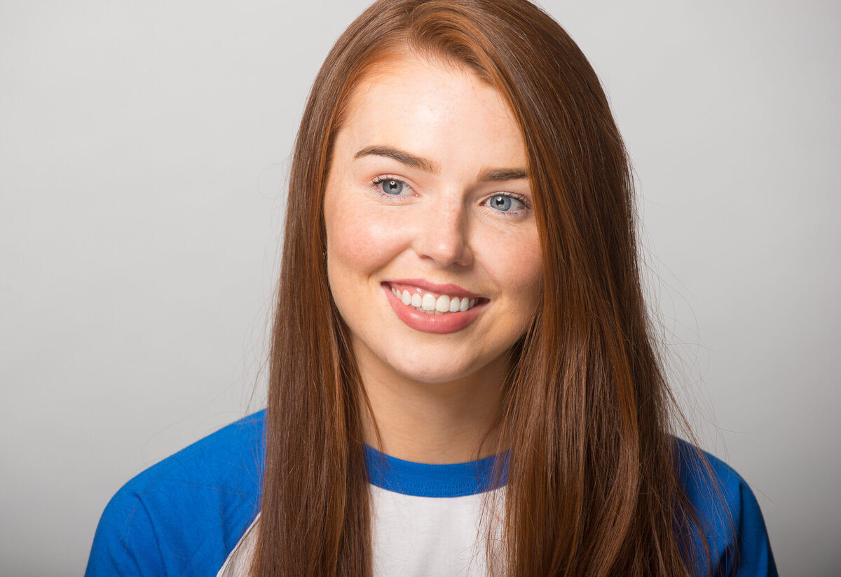 headshot of woman with red hair smiling