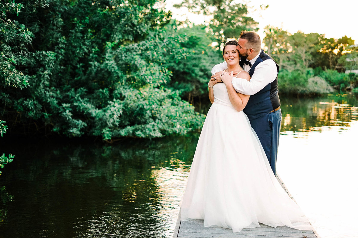 Bride and groom photos on floating dock at La Casa on Mason Creek