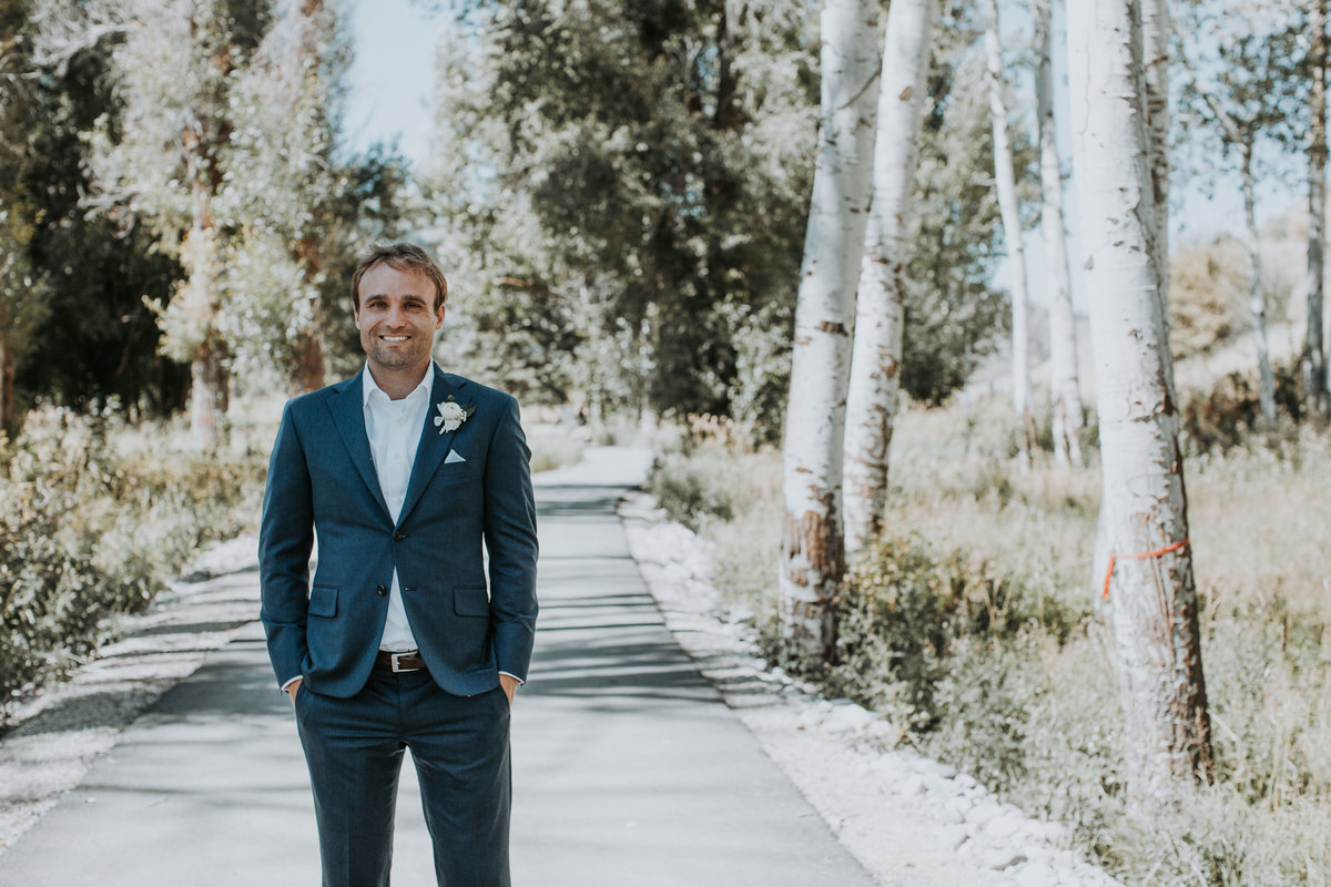 Grooms in Montana wedding with hands in pockets