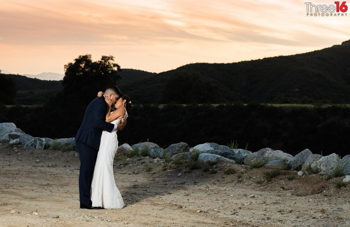 Bride and Groom share an intimate moment during a photo session