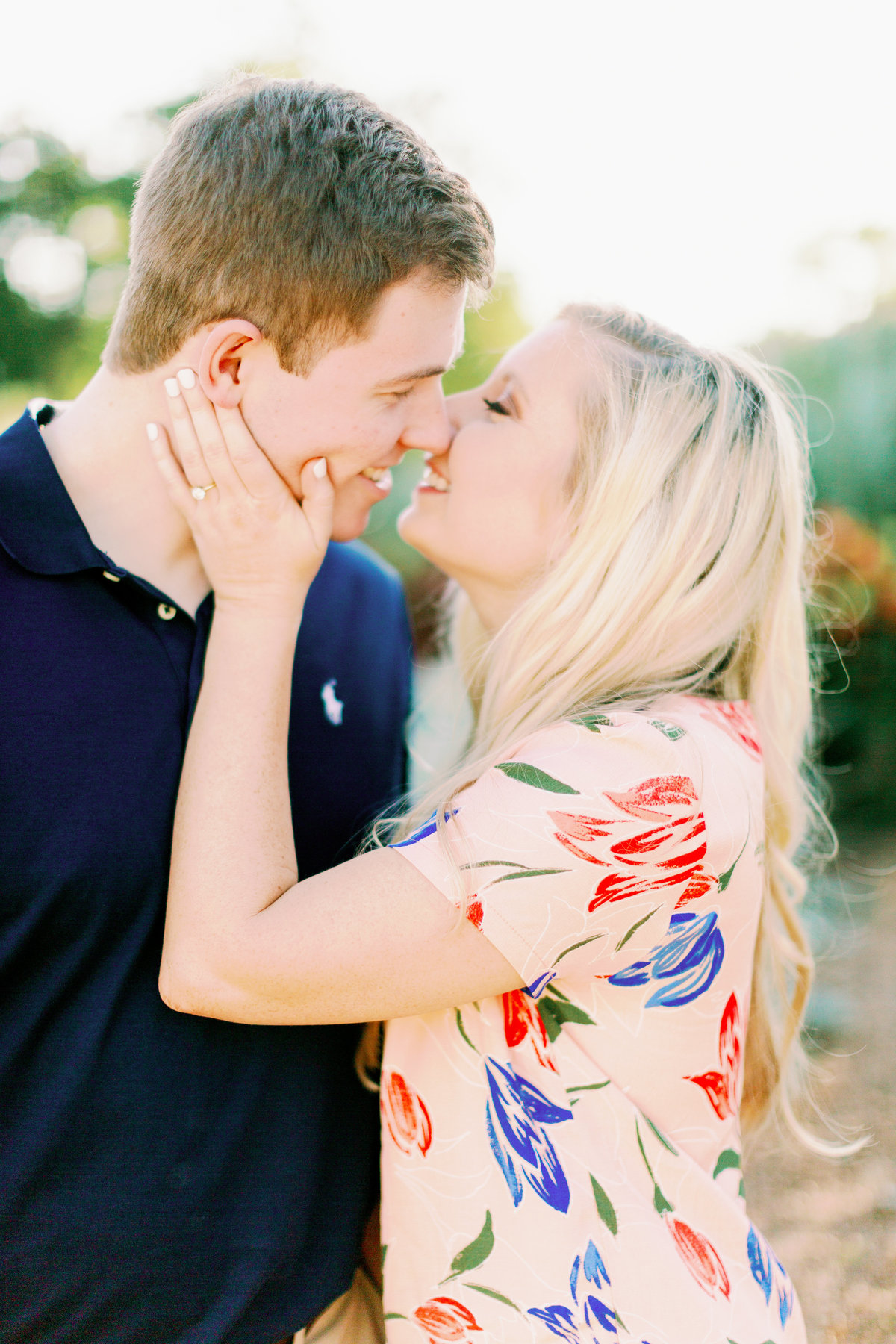 Couple kisses for Albuquerque engagement portraits