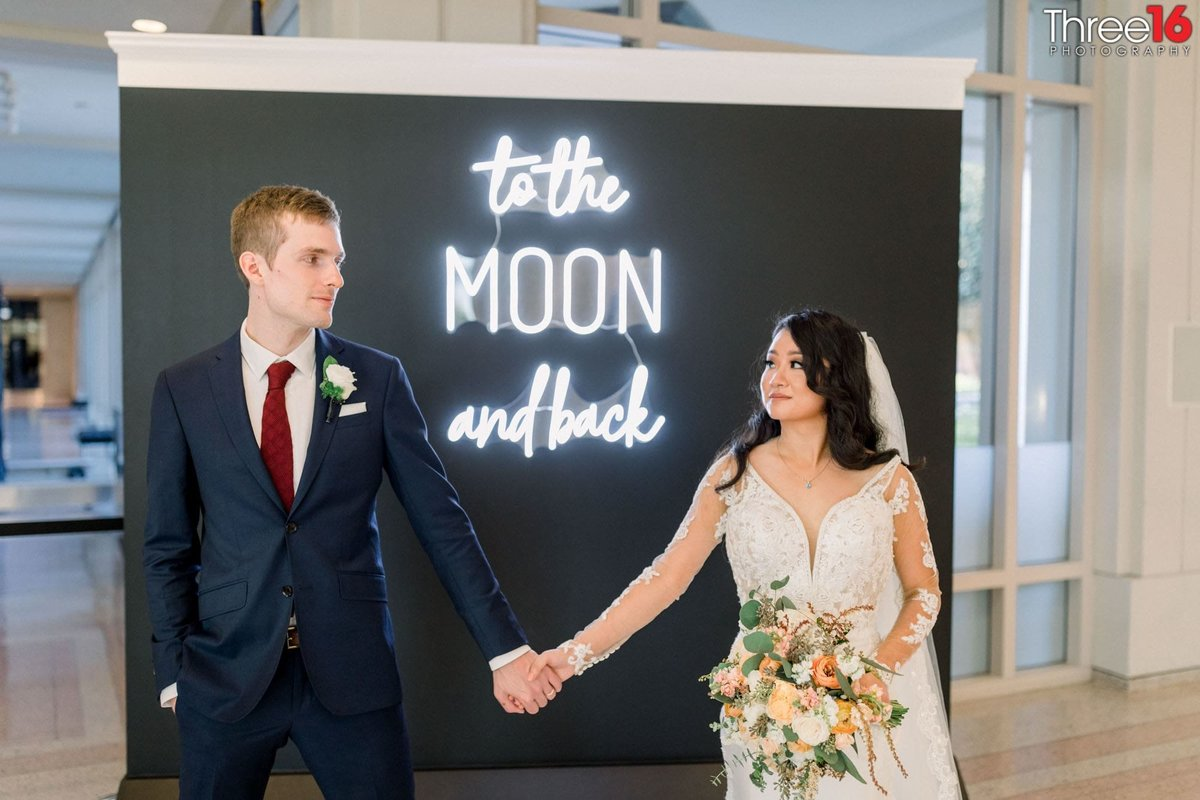 To the Moon and Back as the Bride and Groom pose for photos