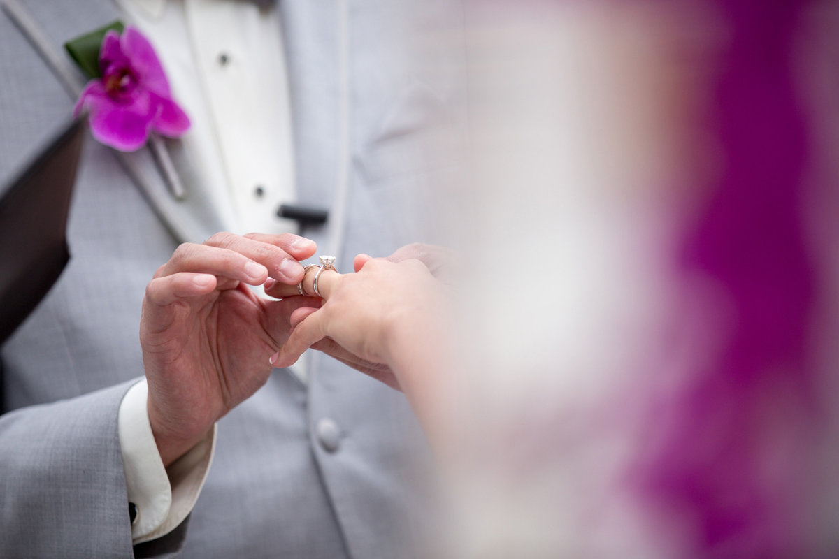 Ring exchange during a wedding ceremony at Bridgeview Yacht Club