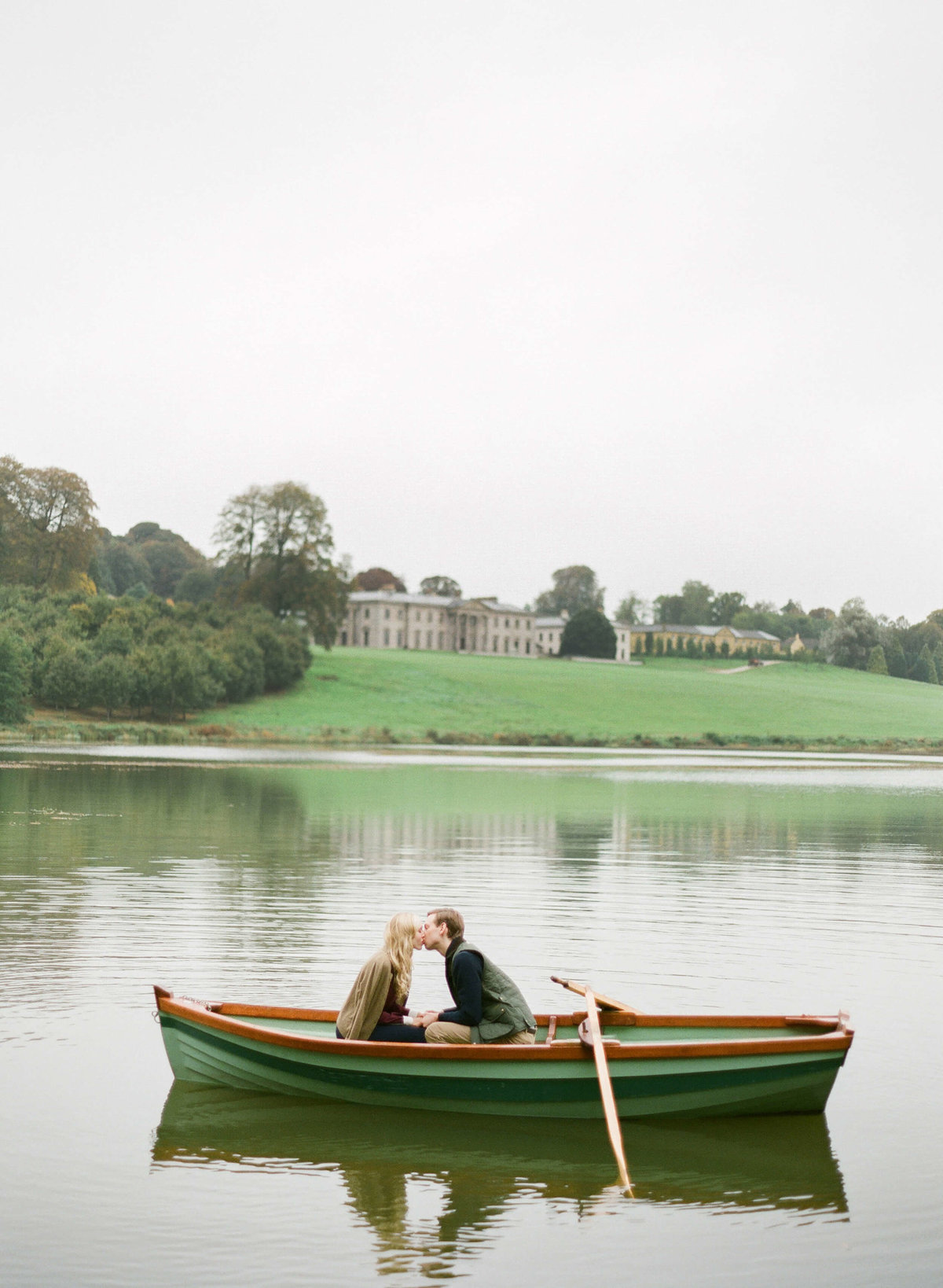14-KTMerry-destination-weddings-Ireland-Ballyfin-couple-boating