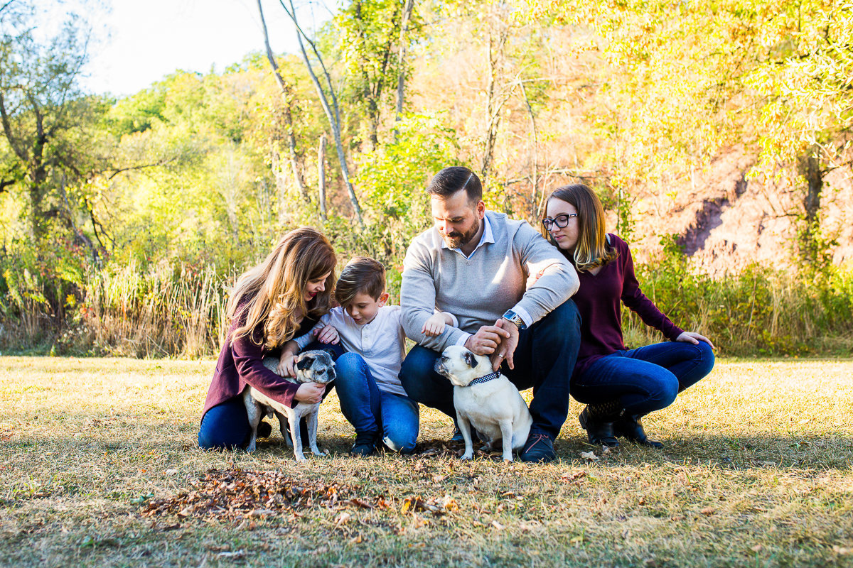 Family of four loving on their two dogs outdoors {Milton Family Photographer}