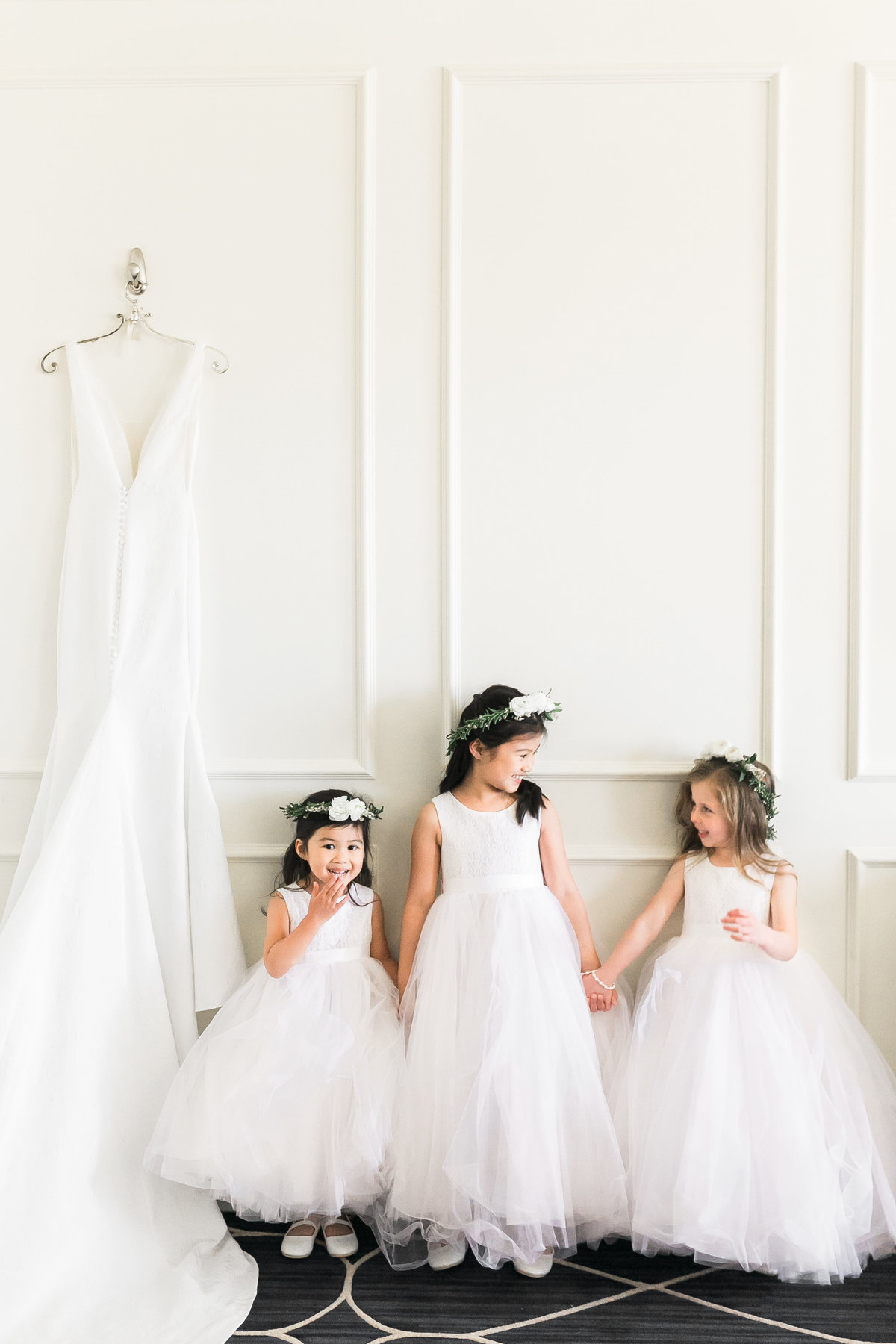 a group of flower girls in tulle white dresses with flower crowns at a wedding at Green Valley Ranch in Las Vegas