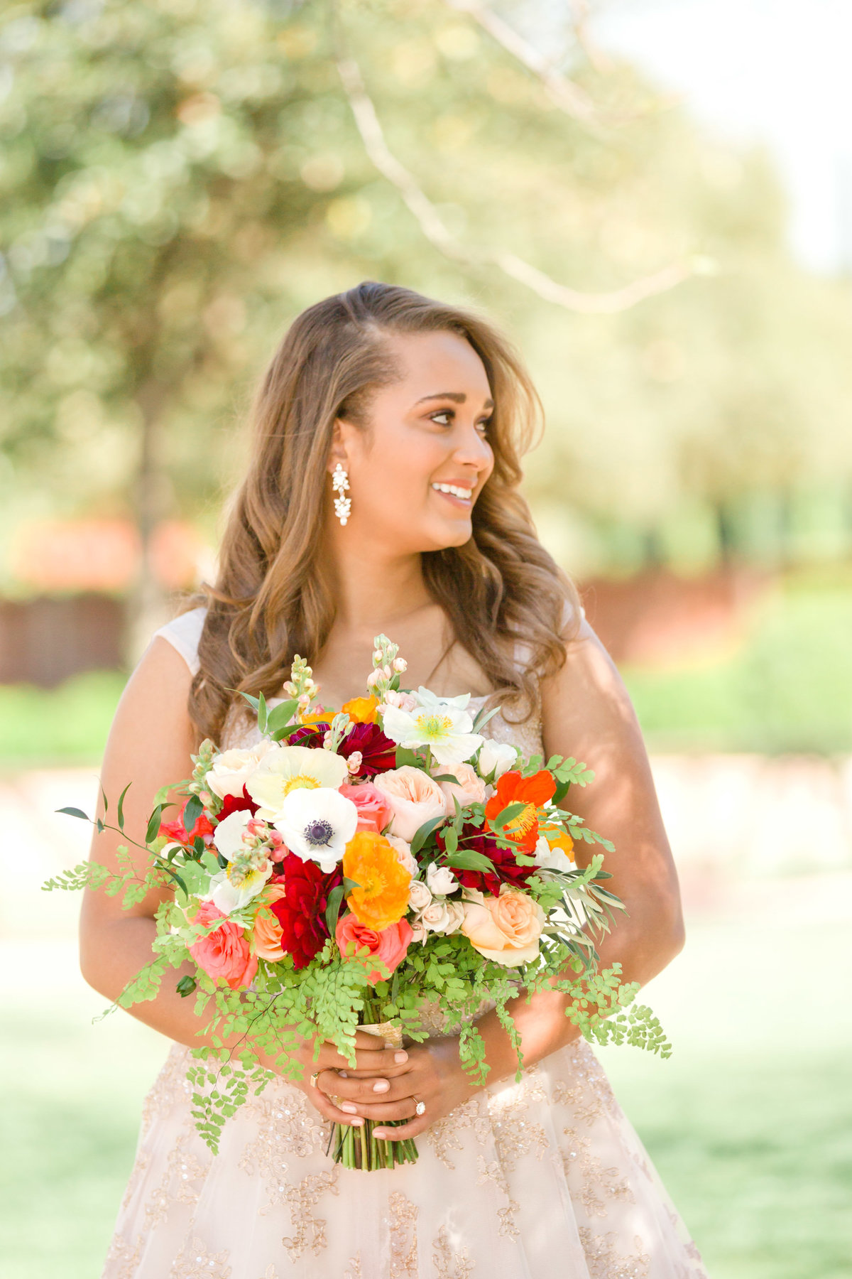 bridal portrait holding bridal bouquet of spring flowers