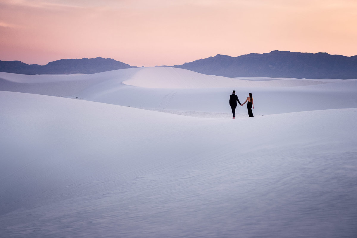 engagement photo couple walking at white sands national park in el paso texas by stephane lemaire photography