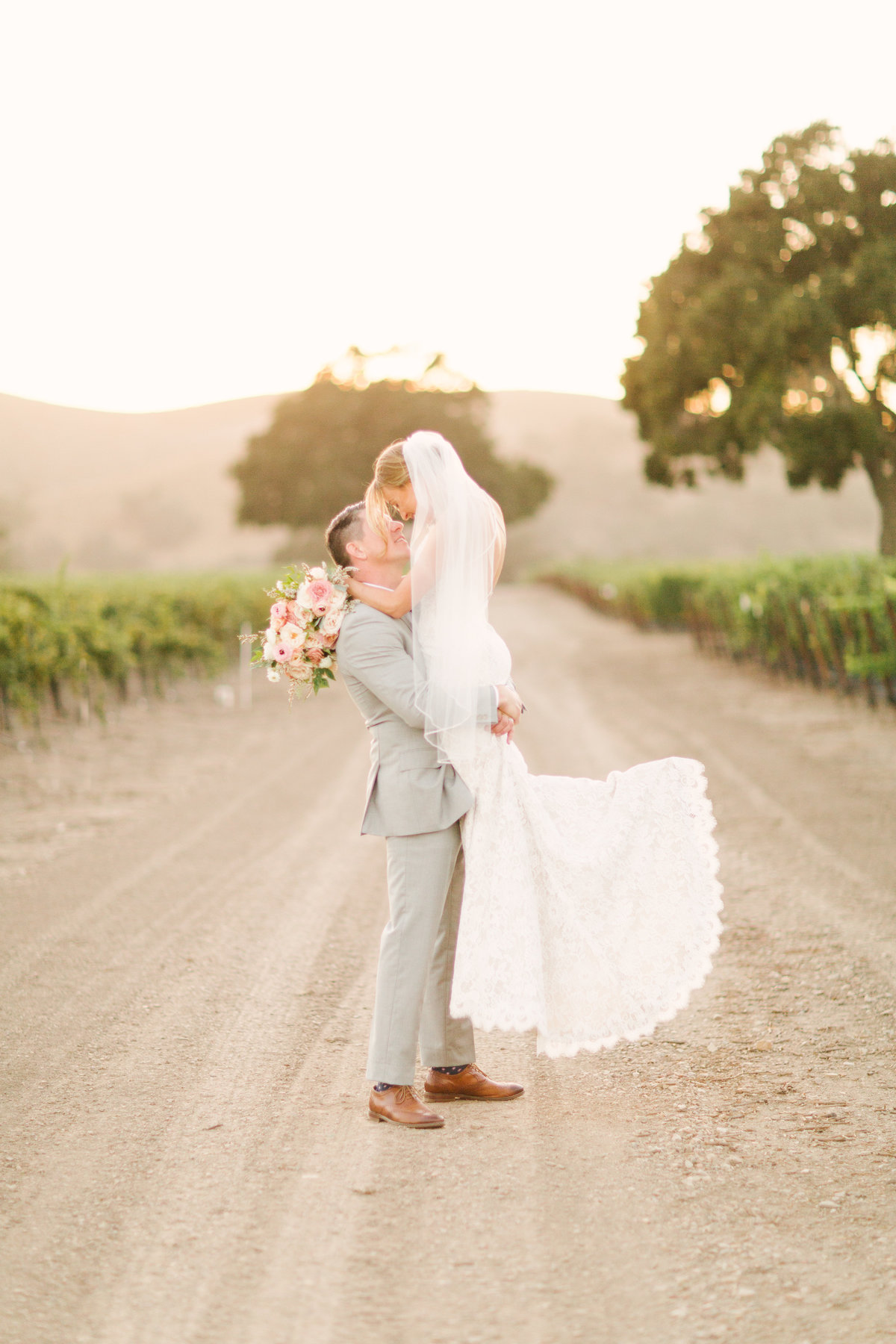 Groom picks up bride at Firestone Vineyard