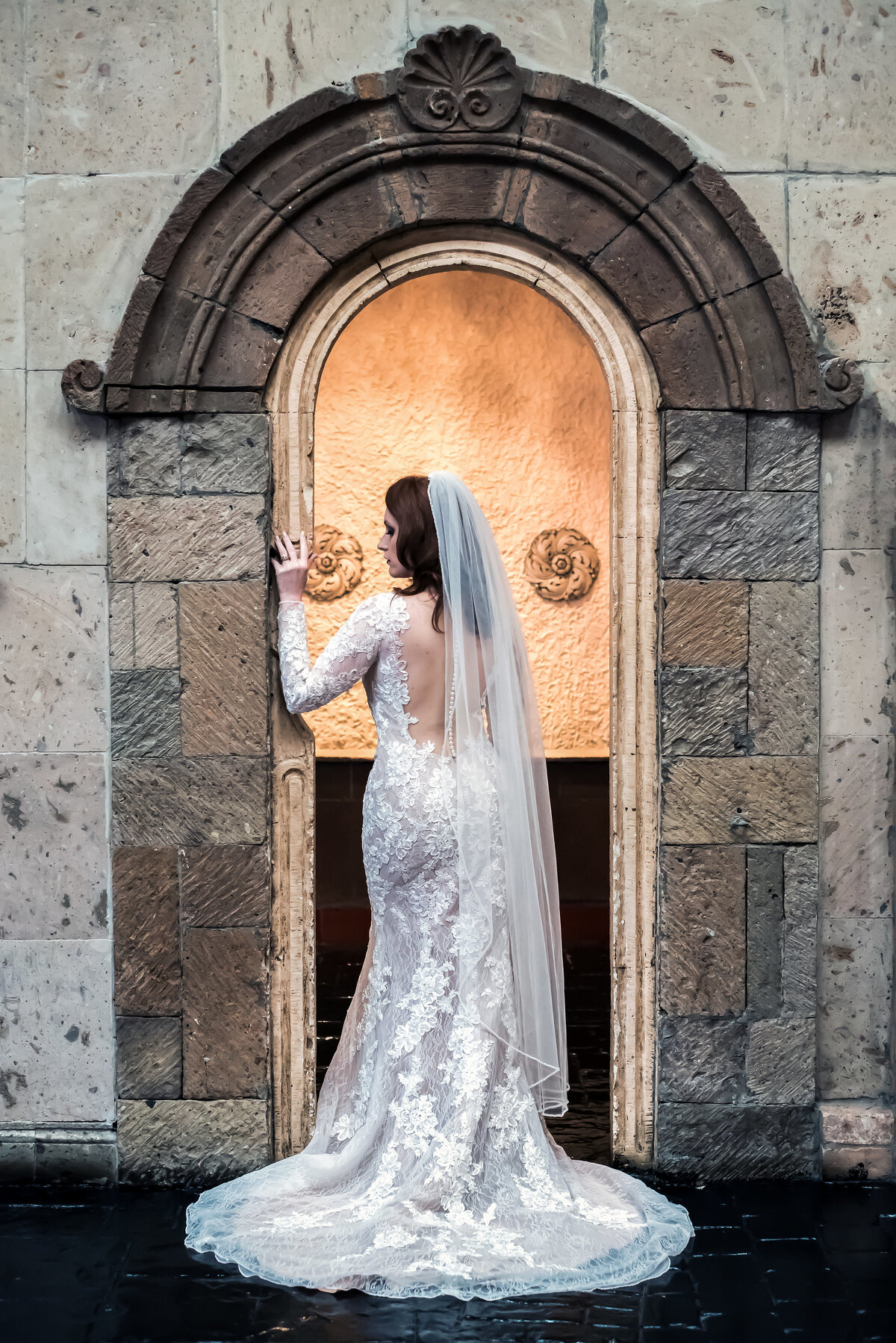 Historic Villa Arch with Backless wedding gown