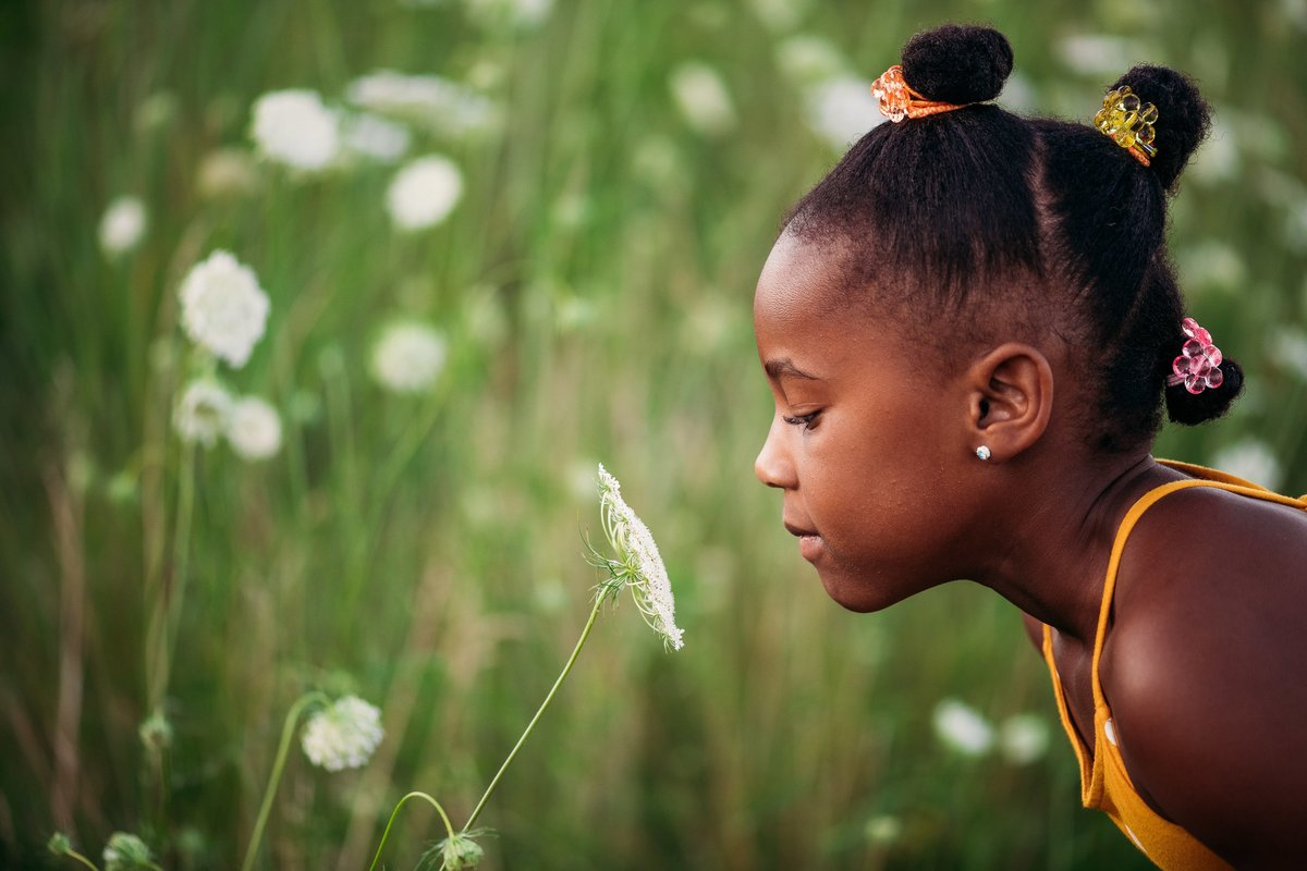 Child smelling flower McKenna Patterson Photography
