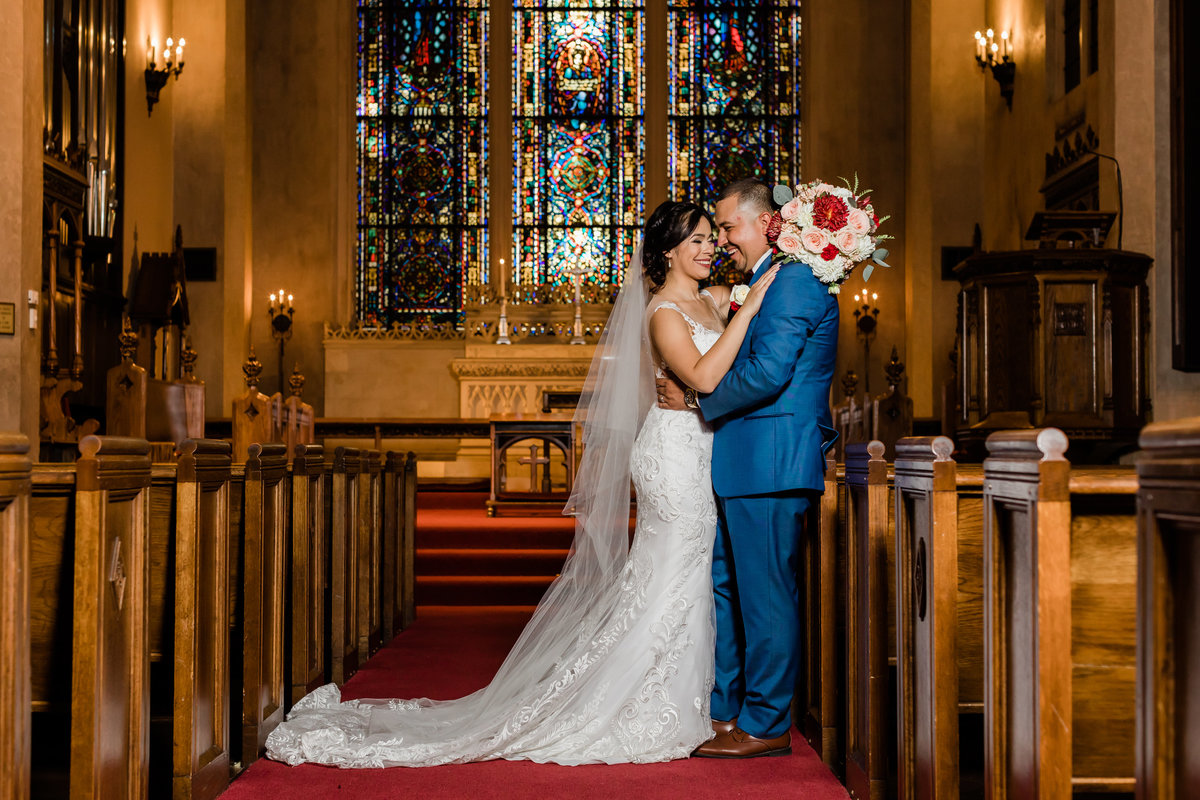 Stockton Wedding at Morris Chapel has beautiful stain glass windows that Susan and Pedro wanted as the backdrop of their couple portraits.