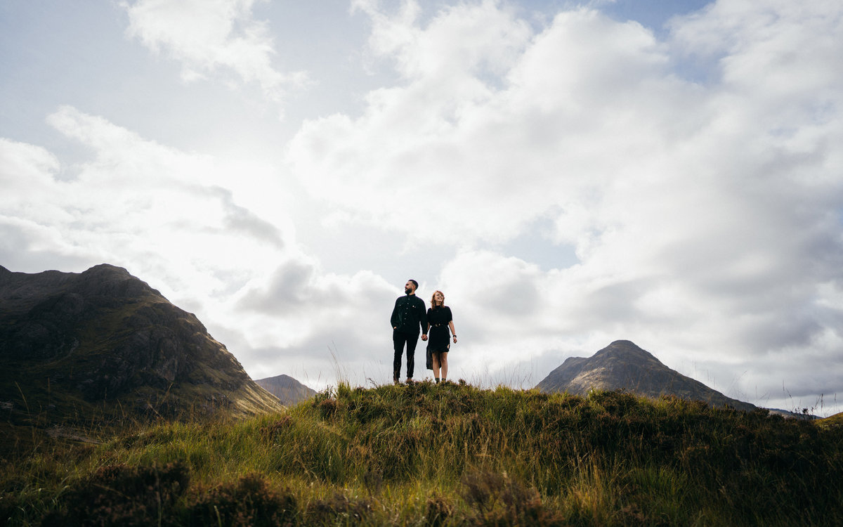 Engagement shoot of couple standing in a beautiful Scottish landscape