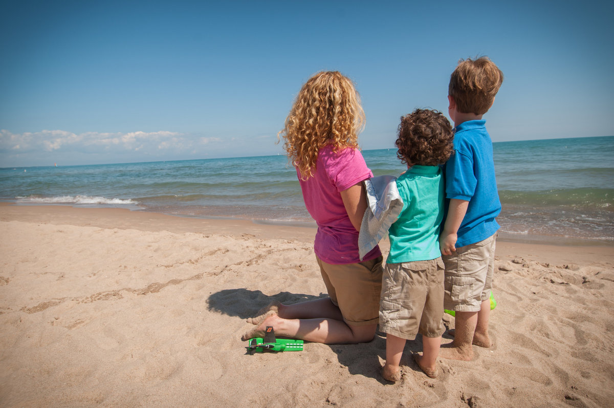 Single mom and her boys during a Lake Michigan beach family portrait session