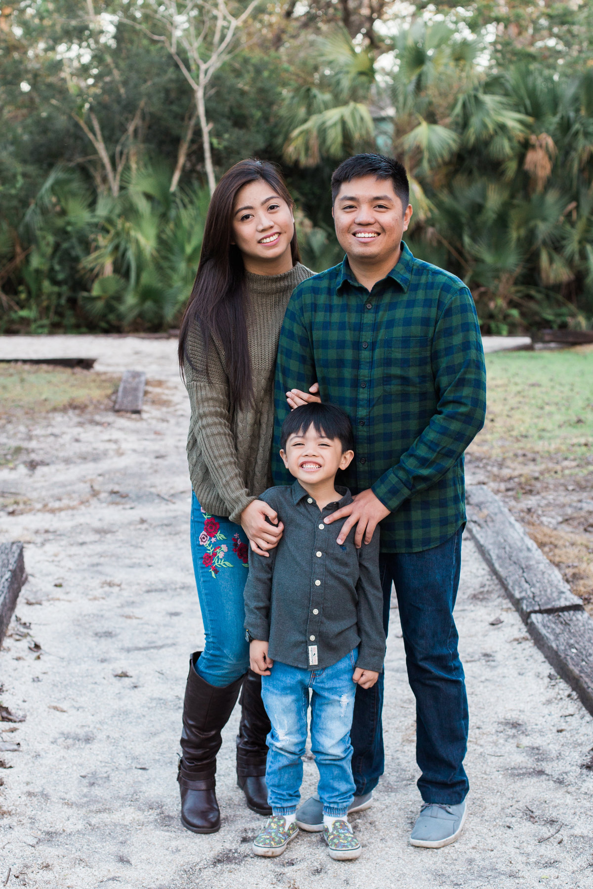 A family portrait of a filipino mother, father and son taken by Jacksonville Family Photographer