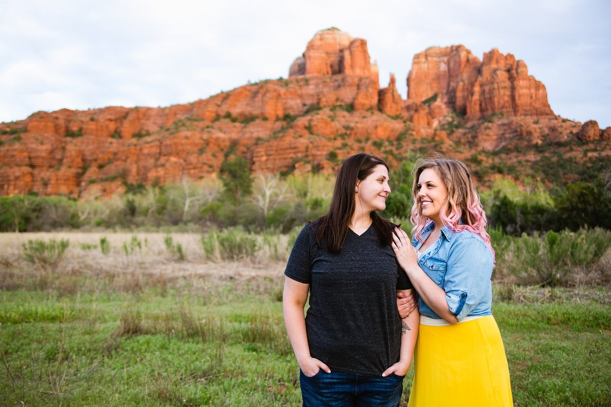 Couple smiling at each other during their Sedona engagement session by PMA Photography.
